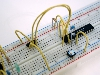 Learn construction techniques such as solderless breadboarding.